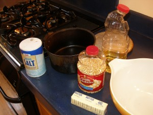 The first step is to gather your ingredients and utensils.  My popcorn pan is well seasoned, having been used for this purpose, and none other, since the 1970's.  The bowl dates from the same period.